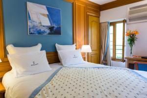 Un ou plusieurs lits dans un hébergement de l'établissement Hôtel Restaurant Du Port