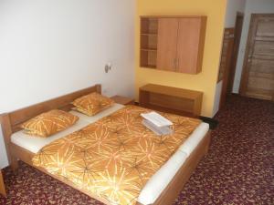 Postel nebo postele na pokoji v ubytování Hotel Fojtů