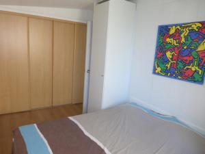 Un ou plusieurs lits dans un hébergement de l'établissement Appartement Iris
