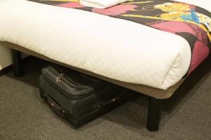 A bed or beds in a room at Laon Inn Gion Nawate