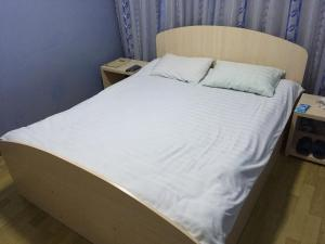 A bed or beds in a room at Hostel Ekonom