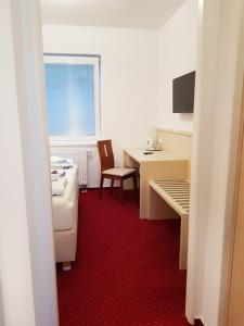 TV a/nebo společenská místnost v ubytování Hotel Bax