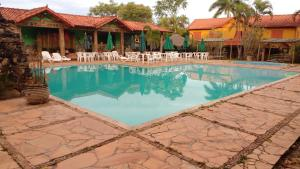 The swimming pool at or near Hotel Serra da Moeda