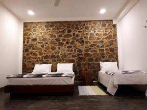 A bed or beds in a room at The Residence