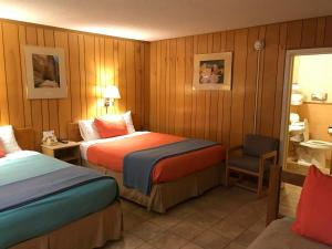 A bed or beds in a room at White Eagle Inn