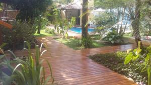 The swimming pool at or near Casa da Arvore Apartamentos Pousada