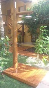 A garden outside Casa da Arvore Apartamentos Pousada