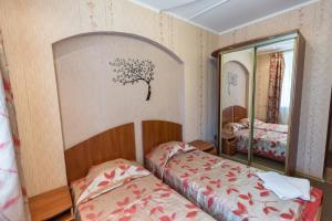 Кровать или кровати в номере Гостиница Рогачев