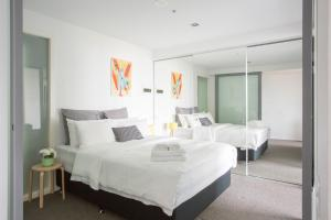 A bed or beds in a room at Canvas Suites on Downie
