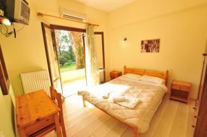 Ένα ή περισσότερα κρεβάτια σε δωμάτιο στο Laskaris Studios
