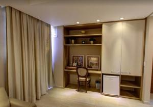 A television and/or entertainment center at Ecos Hotel Tourist