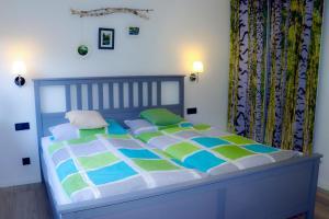 Ein Bett oder Betten in einem Zimmer der Unterkunft Ferienwohnung Saalhausen Sauerland