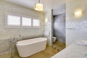 A bathroom at Magnificent Beach House