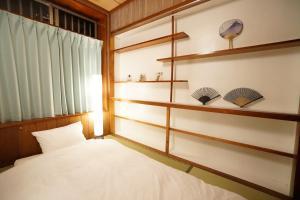 TOKU Marine Houseにあるベッド