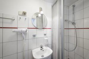 Ein Badezimmer in der Unterkunft Goethezimmer Burgplatz