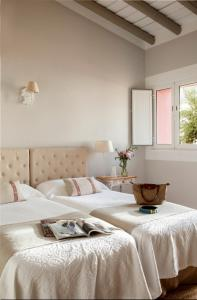 A bed or beds in a room at Hotel & Croquet Club Quinta da Chamine