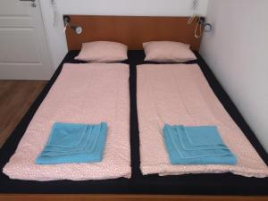 A bed or beds in a room at Omega Guesthouse Budapest