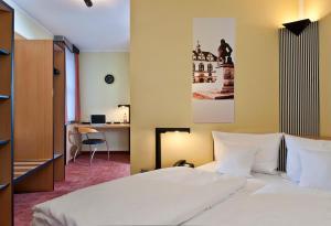 Ein Bett oder Betten in einem Zimmer der Unterkunft TRYP by Wyndham Halle