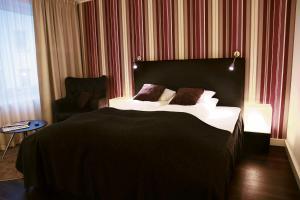 Säng eller sängar i ett rum på First Hotel Witt