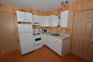 A kitchen or kitchenette at Centre de Vacances 5 Étoiles Family Resort