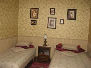 Voodi või voodid majutusasutuse Kalbuse House toas