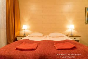 A bed or beds in a room at Rovaniemi City Apartments