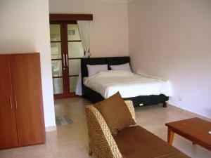 A bed or beds in a room at Fruits Villa