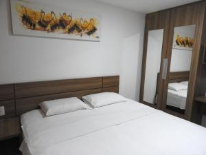 A bed or beds in a room at Jardins do Atlântico