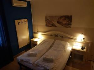 A bed or beds in a room at Hotel La Terrazza