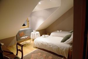 Un ou plusieurs lits dans un hébergement de l'établissement Le Manoir