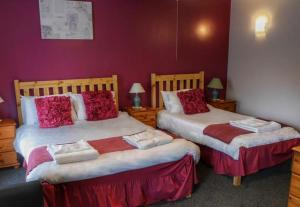 A bed or beds in a room at The Fountain Inn