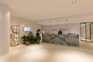 The lobby or reception area at PREMIER SUITES PLUS Rotterdam