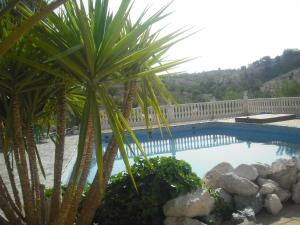 The swimming pool at or near Hotel Los Sibileys