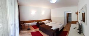 A bed or beds in a room at Cabana Capra