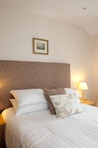 A bed or beds in a room at The Britannia Inn
