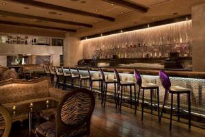 The lounge or bar area at Luxury Suites at Palms Place