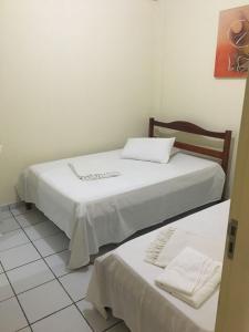 Cama ou camas em um quarto em Pousada Santos