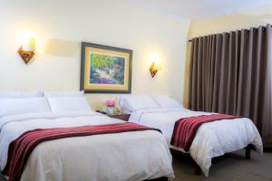 A bed or beds in a room at Hotel Cajamarca