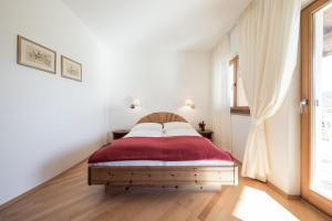 A bed or beds in a room at Weingut Donà