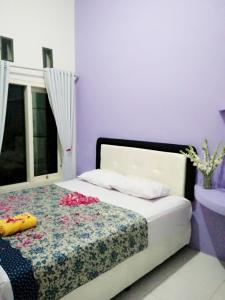 Un ou plusieurs lits dans un hébergement de l'établissement Clover Homestay