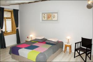 A bed or beds in a room at B&B - La Cense du Pont