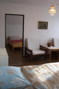 A bed or beds in a room at Ubytovani Trojakova
