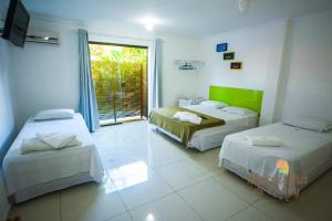 A bed or beds in a room at Pousada Maravilha de Paraty