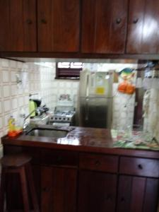 A kitchen or kitchenette at Apartamento Cabo Frio