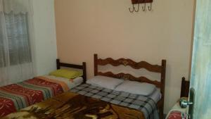 A bed or beds in a room at casas temporada em Tiradentes do mazinho