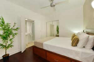 A bed or beds in a room at Club Tropical Resort Book Here With The Only Onsite Reception Open Daily