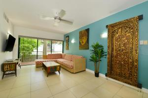 A seating area at Club Tropical Resort Book Here With The Only Onsite Reception Open Daily