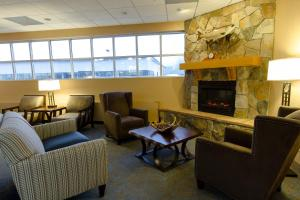 A seating area at GuestHouse Inn & Suites Anchorage Inn