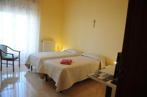 Кровать или кровати в номере Albergo Villa Nobile
