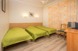 Кровать или кровати в номере Lilleküla Hotel